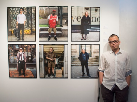 Yiyun Chen with his work at Cleveland Print Room's Spotlight exhibition.